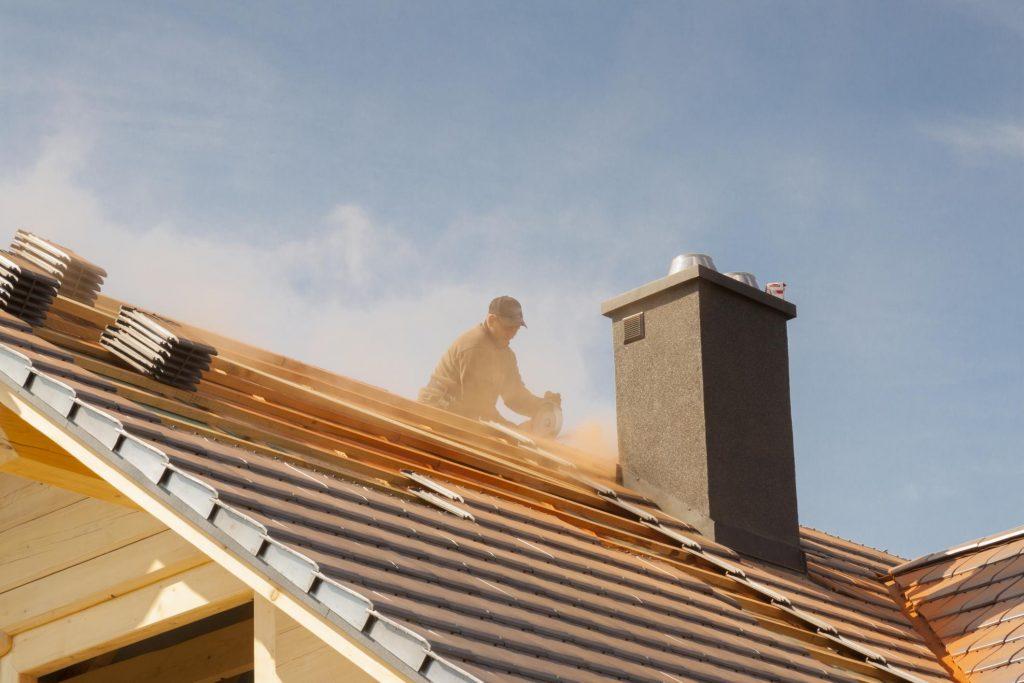 roofer installing house roof
